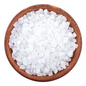 Wooden bowl full of sea salt over white — Stock Photo