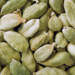 Green cardamom seeds background — Stockfoto #7808487
