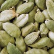 Stock Photo: Green cardamom seeds background