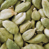 Green cardamom seeds background — Stok fotoğraf