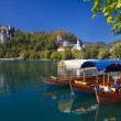 Traditional wooden boats in Bled - Stock Photo