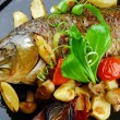 Baked fish with vegetables - Photo