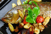 Baked fish with vegetables — Stock Photo
