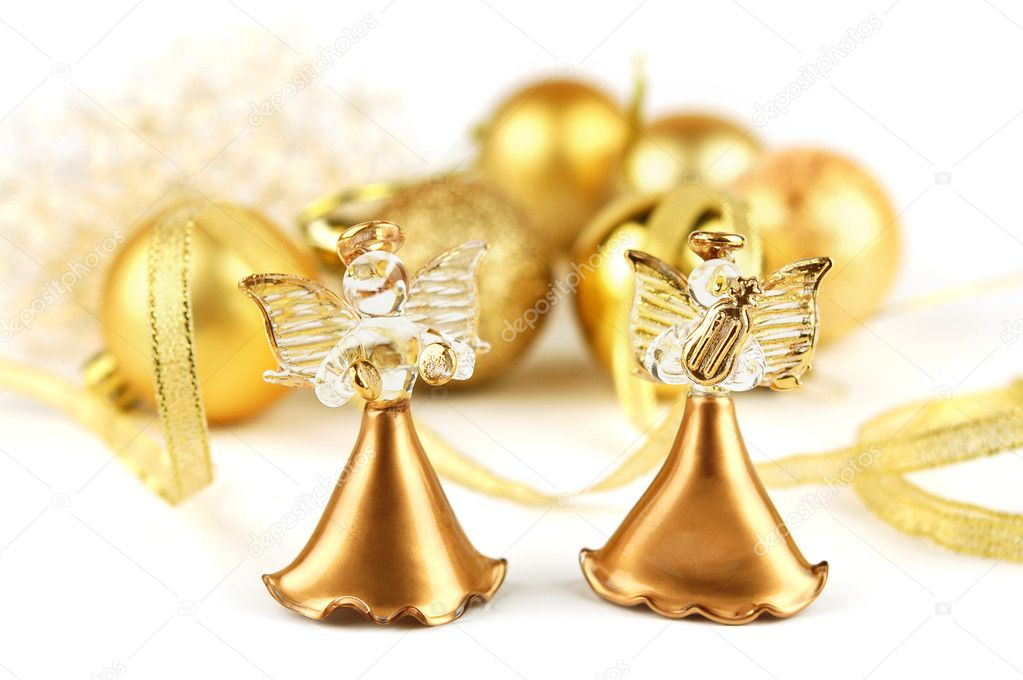 Two figurine of angels on the background of Christmas decorations — Stock Photo #7653157