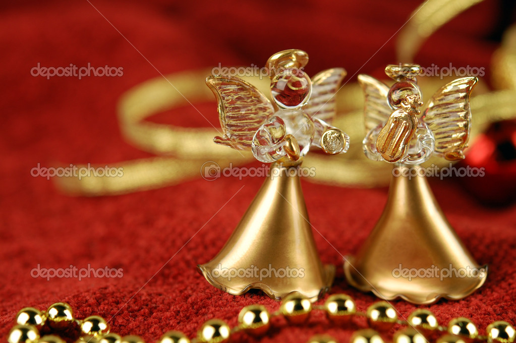 Two figurine of angels on the background of Christmas decorations — Stock Photo #7653183
