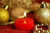 Candle and christmas ornaments — Stock Photo