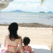 Young lovely mother and her little daughter on tropical white be — Stock Photo #6793049
