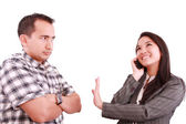 Smiling businesswoman on the phone signaling his couple to hold — Stock Photo