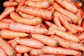 A background of the fresh young carrots. — Stock Photo