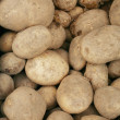 Stock Photo: Potatoes raw vegetables food pattern in market