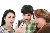Young shock and surprise watching the mobile phone — Stock Photo