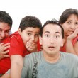 Stock Photo: Closeup portrait of young group with a very surprised look on th