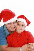 幸せな父と息子クリスマスの帽子とカメラに見える — ストック写真