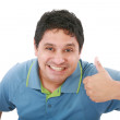 Smiling young man with thumbs up on an isolated white background — Stock Photo #7504750