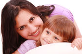 Mother and daughter posing happily in bed — Stock Photo
