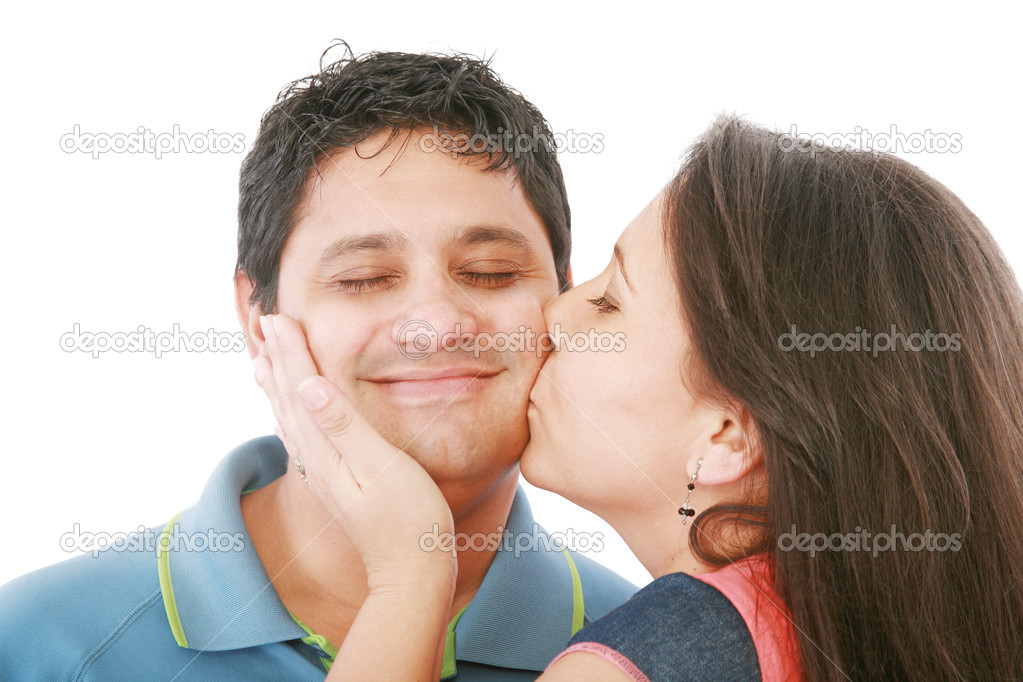 Nice girl kisses the young modest guy on a cheek   Stock Photo #7503651