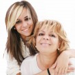 Latin mother and daughter isolated on a white background — Stock Photo