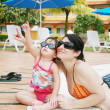 Mother and Daughter Playing in the Pool — Stock Photo