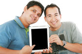 Two young men or businessmen showing a tablet PC computer and sm — Stock Photo