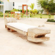Home exterior patio with handcraft wooden sofa with an aligator — Stock Photo
