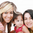 Happy portrait of beautiful young mother with two daughter looki — Stock Photo