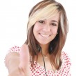 Smiling beautiful woman with thumbs up. Focus on the girl — Stock Photo #7625449
