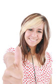 Smiling beautiful woman with thumbs up. Focus on the girl — Stock Photo