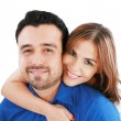 Couple portrait smiling with a white background — Stock Photo #7670609