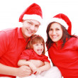 Stock Photo: Happiness family in christmas hat isolated on white