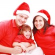 Happiness family in christmas hat isolated on white — Stock Photo #7670700