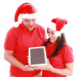 Couple enjoying their new touchpad on christmas — Stock Photo