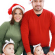 Happy family in Christmas costumes — Stock Photo