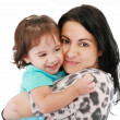 Little girl hugging to mother, in her arms — Stock Photo