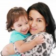 Little girl hugging to mother, in her arms — Stock Photo #7708545