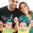 Stock Photo: Young family with twin girls
