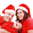 Happiness family in christmas hat isolated on white — ストック写真