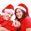Happiness family in christmas hat isolated on white — Stock Photo