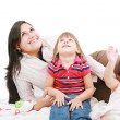Happy caucasian mother and two daughter playing and looking up — Stock Photo
