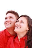 Joven pareja amorosa mirando hacia el cielo, de pie sobre blanco, — Foto de Stock