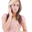 Portrait of shocked woman talking on phone call over white backg — Stock Photo