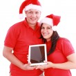Stock Photo: Couple enjoying their new touchpad on christmas