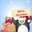 Christmas penguin — Stock Vector #7697023