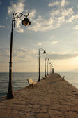 Pefkohori pier at morning — Stock Photo
