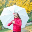 Stock Photo: Cute girl with white umbrellwalking