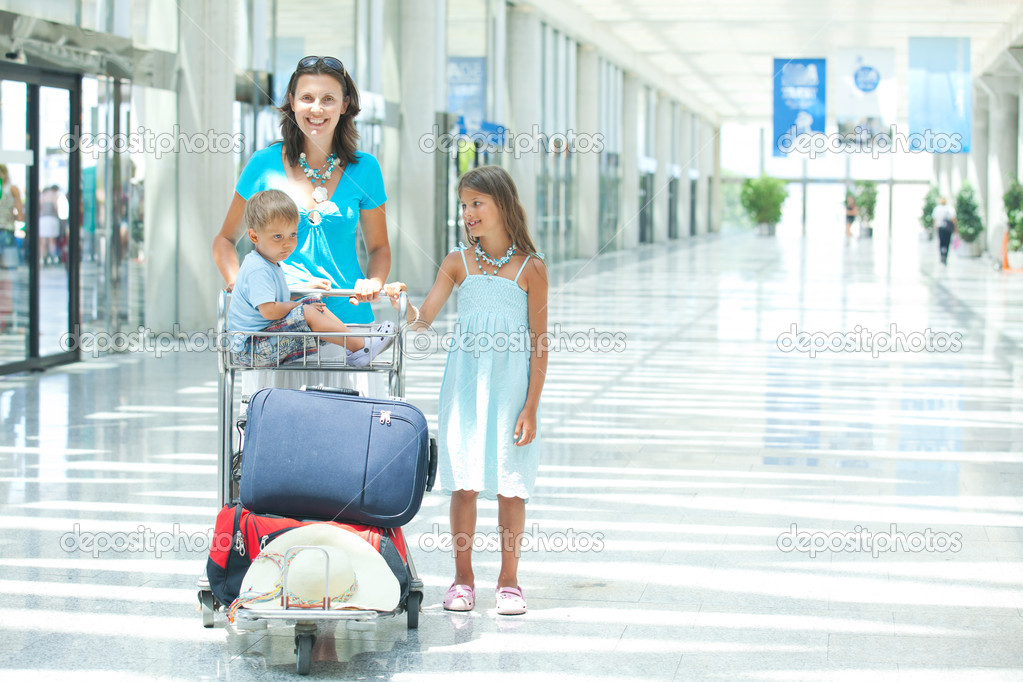 Young mother and child in the airport — Stock Photo #7122306