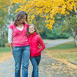 Cute girl with her mother walking in park — Stock Photo