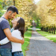 Young Couple Walking in autumn park — Stock Photo