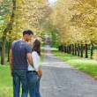 Young Couple Walking in autumn park — Stock Photo #7195838