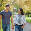 Royalty-Free Stock Photo: Young Couple Walking in autumn park