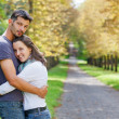 Young Couple Walking in autumn park — Stock Photo #7212495
